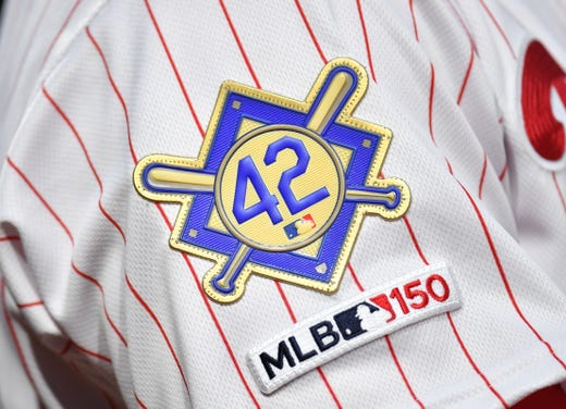 A Jackie Robinson patch is worn on the sleeve of Phillies shortstop Jean Segura. - Rays Pitcher Breaks Toe In Freak Accident