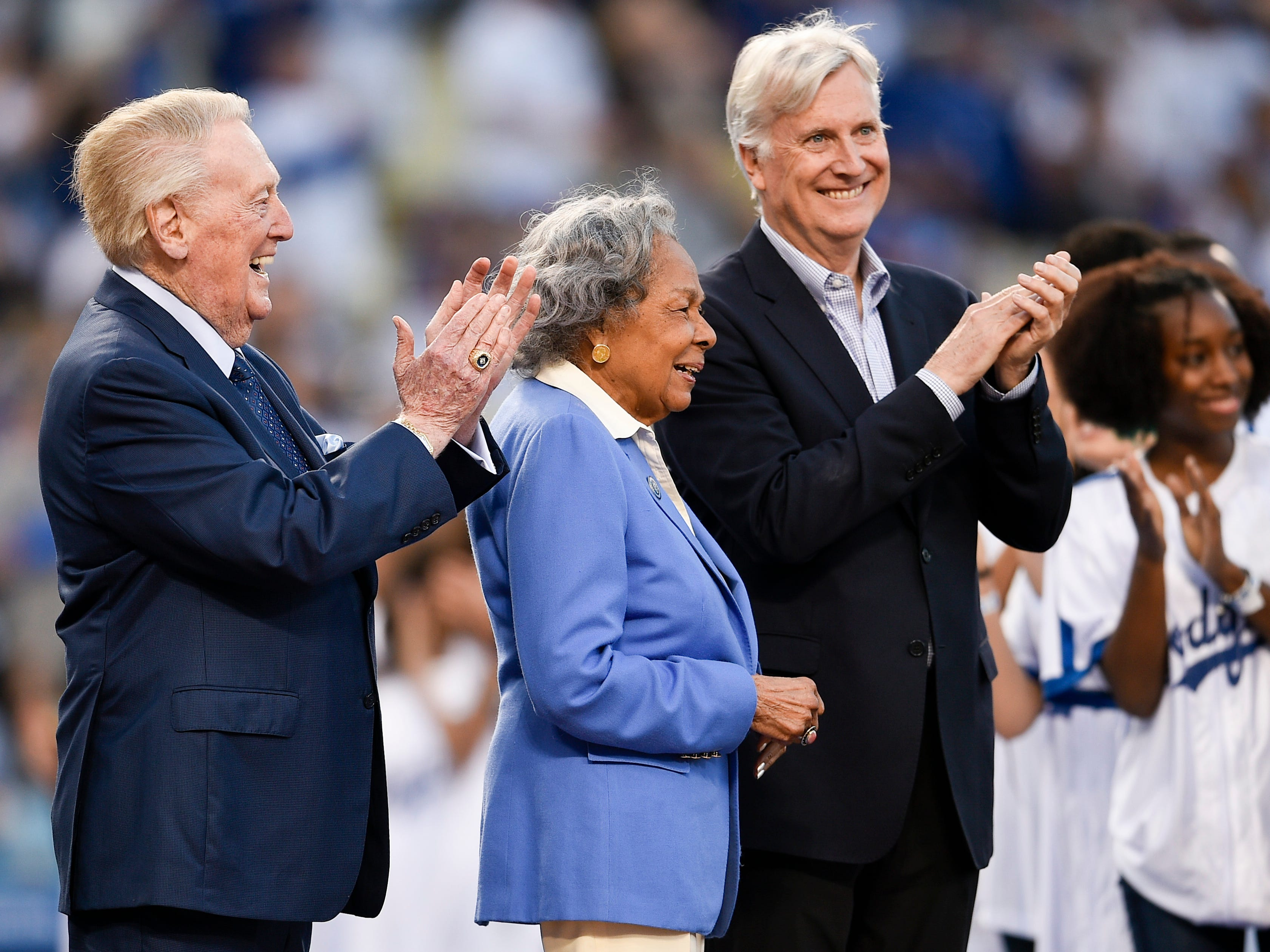 Former Los Angeles Dodgers broadcaster Vin Scully (left) and Rachel Robinson react after the ceremonial first pitch prior to the game against the Cincinnati Reds at Dodger Stadium.