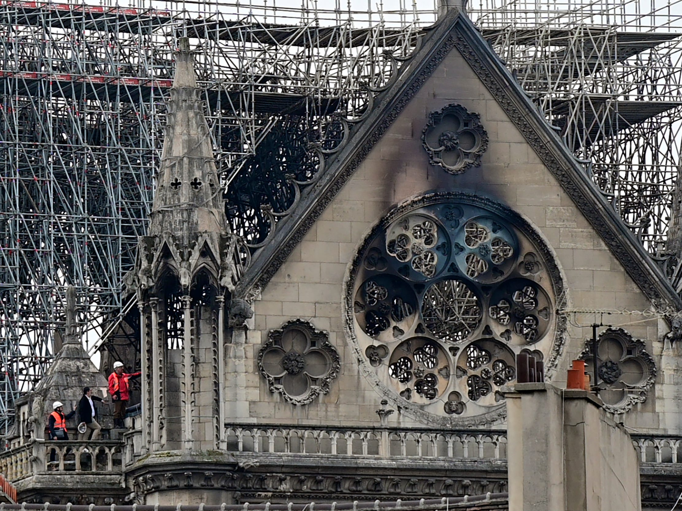 Inspectors are seen on the roof of the landmark Notre Dame Cathedral in central Paris on April 16, 2019.