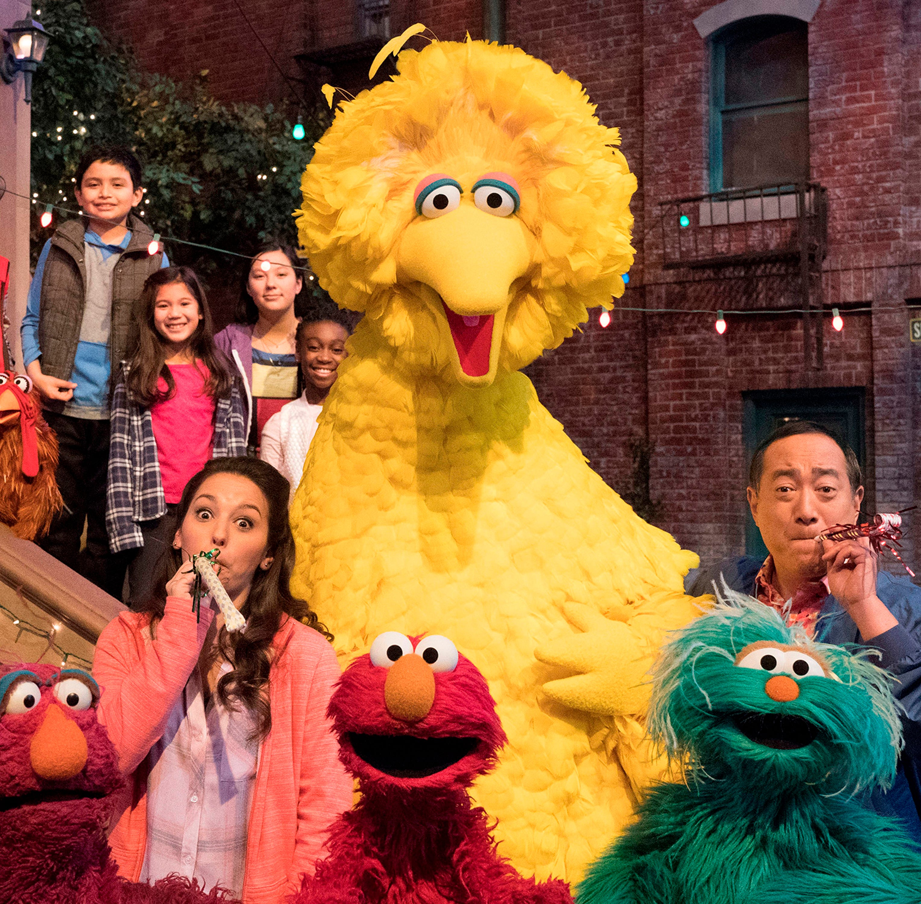 "This image released by HBO shows the cast of the popular children's show ""Sesame Street."" Big Bird, Elmo and stars of ""Sesame Street"" are leaving their quiet neighborhood and hitting the road. The non-profit Sesame Workshop said Tuesday a selection of Muppets will embark on a 10-city trip to celebrate the show's 50th anniversary campaign with free park festivals, live performances and kid-friendly activities."