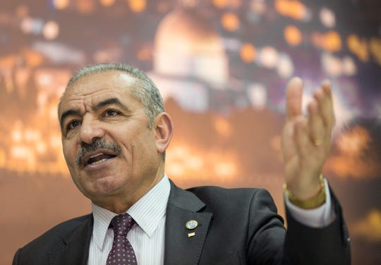 """Palestinian Prime Minister Mohammad Shtayyeh italks during an interview with The Associated Press, at his office in the West Bank city of Ramallah, April 16, 2019. Stayyeh accused the United States of declaring """"financial war"""" on his people and said an American peace plan purported to be in the works will be """"born dead."""""""