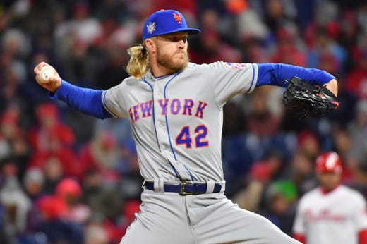 Mets starting pitcher Noah Syndergaard, wearing No. 42, throws a pitch. - Rays Pitcher Breaks Toe In Freak Accident