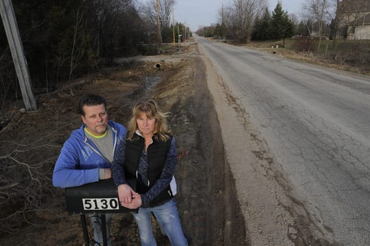 Grand Chute residents Dave Mischler and Patti Stenson face a $16,386 special assessment for the urbanization of Spencer Street between Casaloma and Mayflower drives.