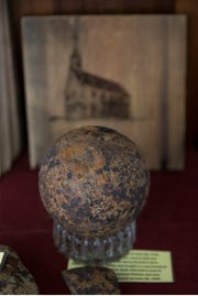 The Old Tennent Presbyterian Church founded in 1692 is still active today meeting in its church which was constructed in 1751. Rev. Douglas Hughes, Pastor, reveals some of the history of the church which dates back prior to the Revolutionary War. Canon balls and other war memorabilia found on church grounds are on display.