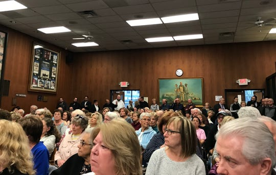 Residents pack the Lakewood Township courtroom on Tuesday, April 16, 2019, for a hearing on a plan to put 278 duplex buildings at Eagle Ridge Golf Club.