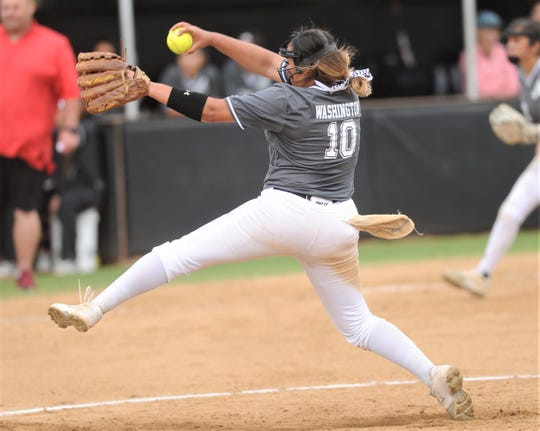 Abilene High pitcher Kaylen Washington throws a pitch in the second inning against Euless Trinity. The Lady Eagles won the game 12-0 in five innings on Tuesday, April 16, 2019, at the AHS softball field for a perfect 12-0 run to wrap up the District 3-6A title.