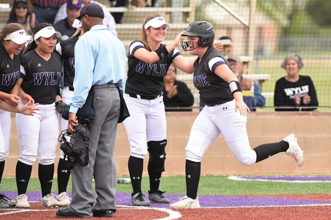 Wylie's Bailey Buck (4) comes home after hitting a solo home run to end the game against Wichita Falls Rider on  April 16. The Lady Bulldogs won 11-1 in six innings.