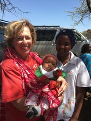Cynthia Hale holds a baby at a medical clinic the Presbyterians held while in Namelok, Kenya.