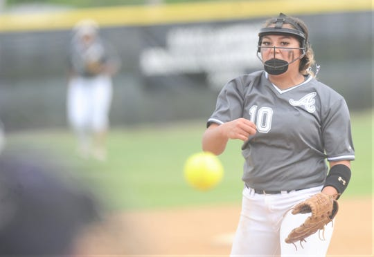 Abilene High pitcher Kaylen Washington throws a pitch to a Euless Trinity batter in the third inning. The Lady Eagles won the  game 12-0 in five innings Tuesday, April 16, 2019, at the AHS softball field. The win gave AHS a 12-0 District 3-6A title.