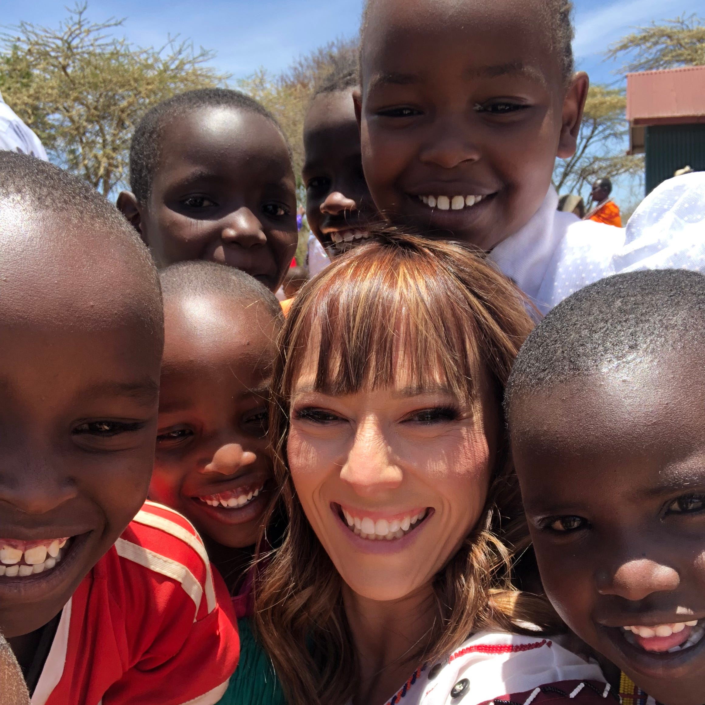 Stephanie Munshower with children at Namelok, Kenya.