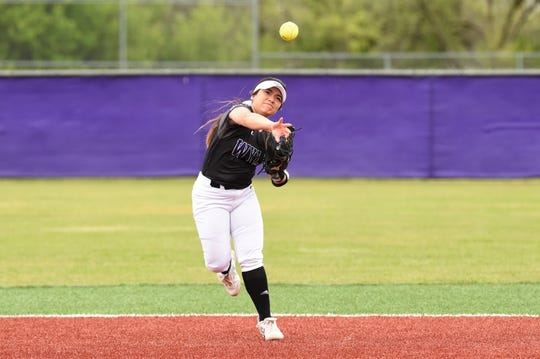 Wylie shortstop Halle Arbilera (8) throws to first for an out against Wichita Falls Rider on Tuesday, April 16, 2019. The Lady Bulldogs won 11-1 in six innings on senior night.