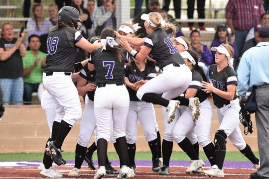 Wylie's Bailey Buck (4) is congratulated at home plate after hitting a game-ending home run against Wichita Falls Rider in 2019. The Lady Bulldogs won the District 4-5A title and reached the Region I-5A semifinals a year ago and were off to a 14-3 start in 2020 before the rest of the season was canceled due to the coronavirus pandemic.