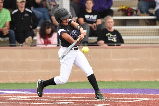 Wylie outfielder Valery Alvarado (6) turns on a pitch for a single against Wichita Falls Rider on Tuesday, April 16, 2019. The Lady Bulldogs won 11-1 in six innings on senior night.