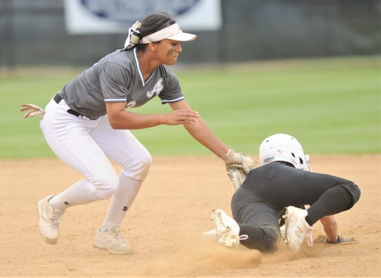 Abilene High shortstop Alyssa Washington tags out Euless Trinity runner Angela Chicas, who was trying to steal second base in the fifth inning. The Lady Eagles beat Trinity 12-0 in five innings to wrap up a 12-0 record in District 3-6A play on Tuesday, April 16, 2019, at the AHS softball field.