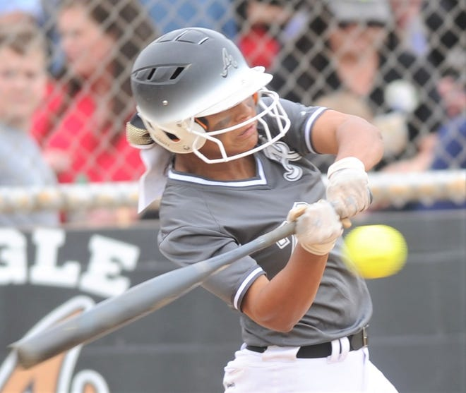 Abilene High's Alyssa Washington singles in the second inning against Euless Trinity. She scored on Kaylen Washington's ground out in the inning for an 8-0 lead. The Lady Eagles beat Trinity 12-0 in five innings April 16 at the AHS softball field to wrap up a 12-0 District 3-6A title. Washington signed with Texas on Wednesday.