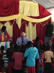 Pastor Cliff Stewart offers a prayer while in Namelok, Kenya.