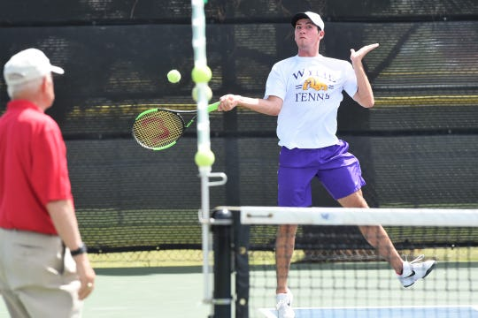 Wylie's Lane Adkins lines up a shot during the Region I-5A mixed doubles semifinal at the McLeod Tennis Center in Lubbock on Wednesday, April 17 2019. Adkins and partner Analeah Elias won 6-3, 6-3 to reach Thursday's final.
