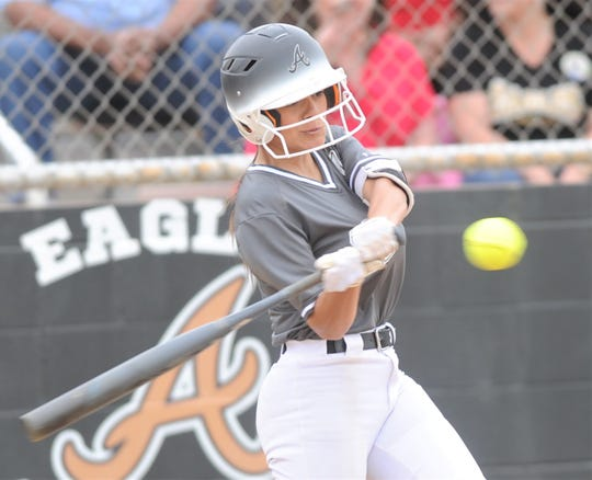 Abilene High's Aubrianna Salazar hits an RBI double off Euless Trinity pitcher Emilee Rhoades in the first inning. Salazar also scored in the six-run first inning. Salazar went 2 for 2 with a walk and three runs in the game. The Lady Eagles beat Trinity 12-0 in five innings to wrap up a 12-0 record in District 3-6A play on Tuesday, April 16, 2019, at the AHS softball field.