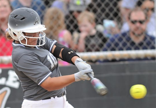 Abilene High's Kaylen Washington hits an RBI ground out to shortstop against Euless Trinity. The Lady Eagles beat Trinity 12-0 in five innings Tuesday, April 16, 2019, at the AHS softball field to wrap up a 12-0 District 3-6A title.