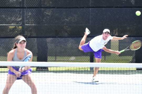 Wylie's Lane Adkins, right, serves behind partner Analeah Elias during the Region I-5A mixed doubles semifinal at the McLeod Tennis Center in Lubbock on Wednesday, April 17 2019. Elias and Adkins won 6-3, 6-3 to reach Thursday's final.