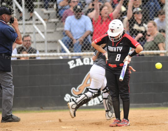 Euless Trinity's Mackenzie Lucio, right, stands at the plate after taking a called strike from Abilene High pitcher Kaylen Washington to end the game. It was the 11th strikeout for Washington, who gave up only one hit. The Lady Eagles beat Trinity 12-0 in five innings to wrap up a 12-0 record in District 3-6A play on Tuesday, April 16, 2019, at the AHS softball field.