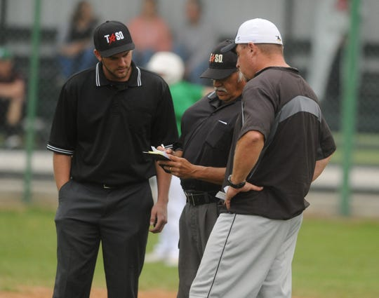 Cisco coach Mark Adams, right, discusses his lineup with the umpires in a District 6-3A baseball game Tuesday, April 16, 2019, in Bangs.