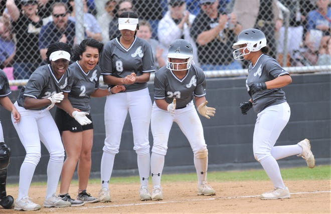 Abilene High players celebrate as K'Ci Walker, right, approaches home plate after hitting a three-run home run to cap a four-run fourth inning. The Lady Eagles beat Euless Trinity 12-0 in five innings to wrap up a 12-0 record in District 3-6A play on Tuesday, April 16, 2019, at the AHS softball field.