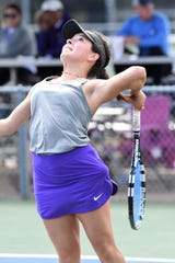 Wylie's Analeah Elias goes up to serve during the Region I-5A mixed doubles semifinal at the McLeod Tennis Center in Lubbock on Wednesday, April 17 2019. Elias and partner Lane Adkins won 6-3, 6-3 to reach Thursday's final.