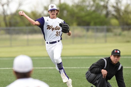 Wylie second baseman Tyler Martin (31) throws on the run for the final out against Wichita Falls Rider on Tuesday, April 16, 2019. Martin had two hits and scored twice in the 12-1, five-inning win.