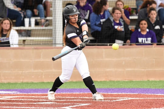 Wylie shortstop Halle Arbilera (8) swings at a pitch against Wichita Falls Rider on Tuesday, April 16, 2019. Arbilera had two hits and two RBIs in her final game at Lady Bulldog Field