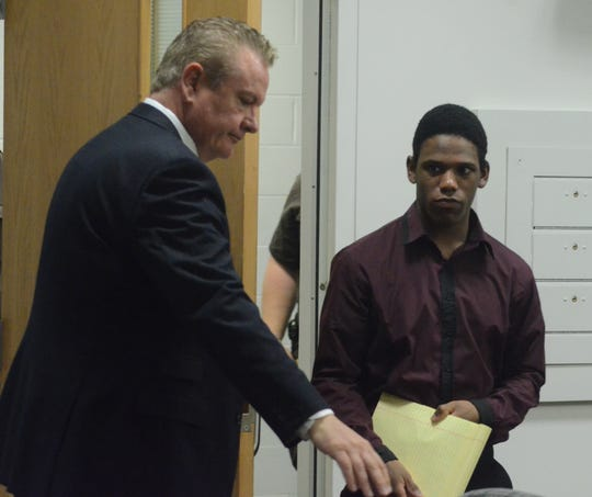 Davion Brown enters the courtroom Wednesday with his attorney Donald Sappanos.