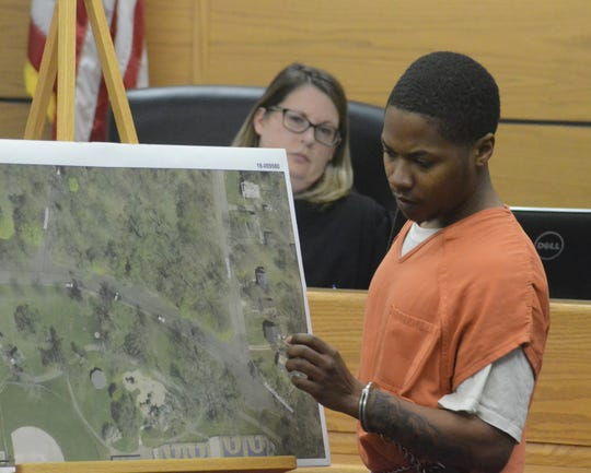 Anthony Prude uses a map to testify about the day of the shooting as Circuit Judge Sarah Lincoln listens.