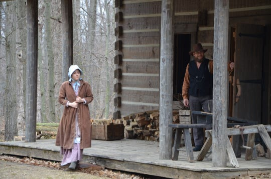 """""""Ada Merrill"""" (Whitney Beaird) greets Verona Elementary third grade students as they arrive on the homestead as part of the Pioneer Cabin Program on Tuesday, April 16, 2019."""