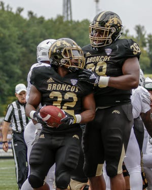 Western Michigan running back Jamauri Bogan (32) celebrates with teammate Odell Miller (38) after scoring a touchdown against Eastern Michigan on Oct. 6, 2018 in Kalamazoo.
