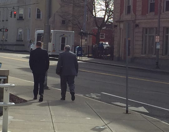 Daniel Butash, left, and his defense lawyer Kurt Schrader leave Broome County Court.