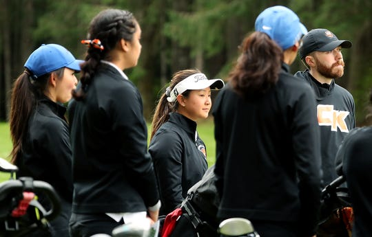 Central Kitsap golfer Brittany Kwon (center) gets ready to start their match against Shelton at Gold Mountain Golf Club on Tuesday, April 16, 2019.