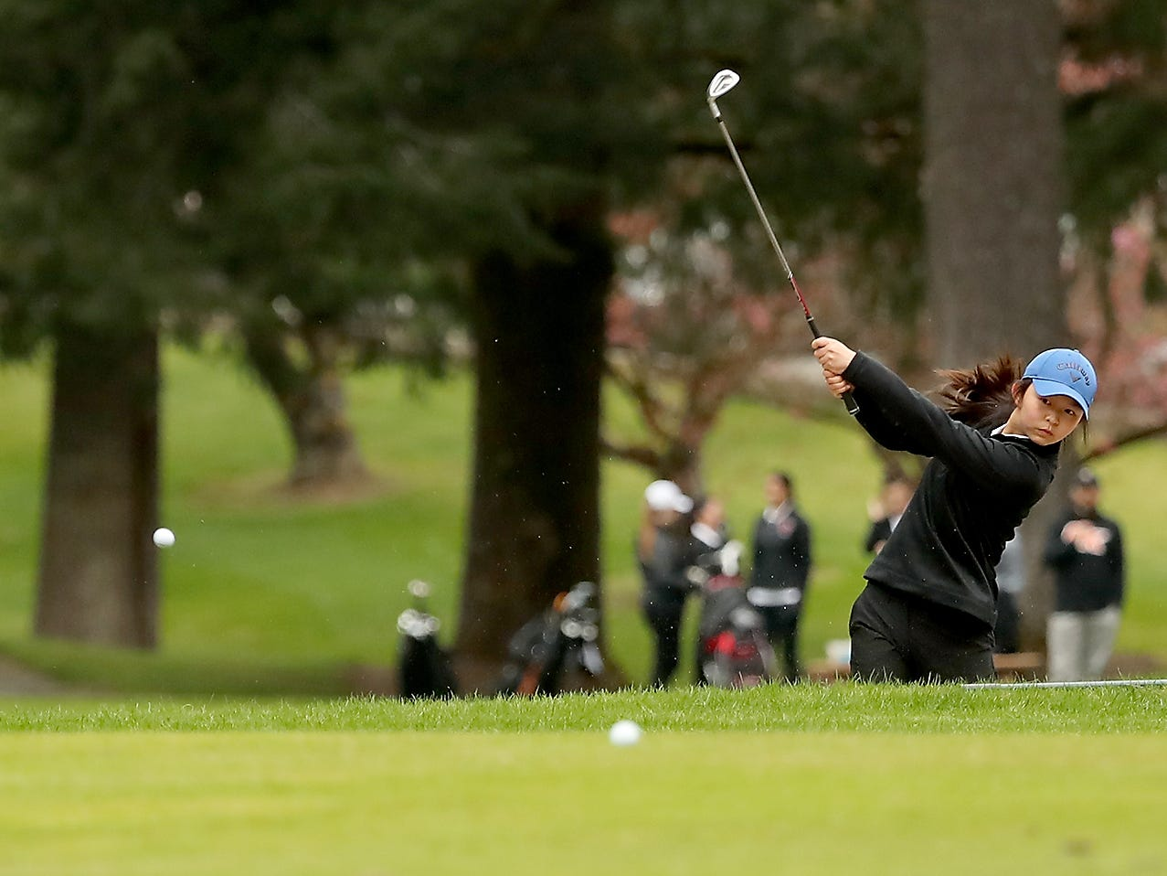 Central Kitsap Golfer Rachel Tan takes a shot during her round at Tuesday's match against Shelton at Gold Mountain Golf Club on Tuesday, April 16, 2019.