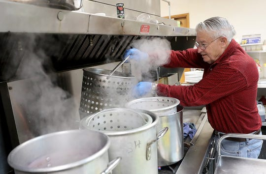 Henry Altenburg hard boils eggs in colored dye as he and fellow Elks members get ready for the upcoming Easter Egg Hunt at the Elks Lodge in Bremerton.