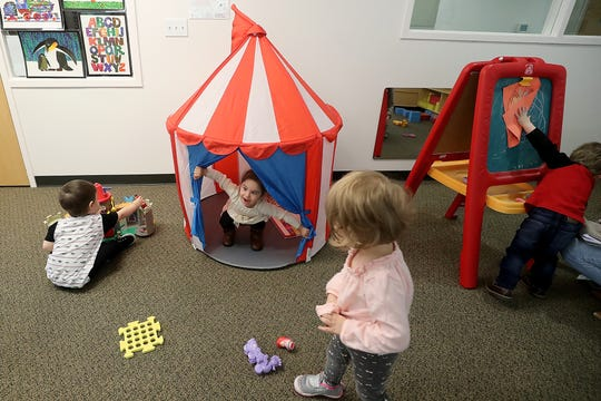 Rosalie Medina, 2, center, peeks out of a small circus tent while playing with classmates at Holly Ridge in Bremerton on Wednesday. Holly Ridge debuted classes at its new Kitsap Way location earlier this year.