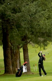 Central Kitsap golfer Brittany Kwon hits a shot at Gold Mountain Golf Club on Tuesday, April 16, 2019.