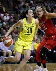FILE - In this Sept. 7, 2018, file photo, Seattle Storm's Breanna Stewart (30) drives past Washington Mystics' Elena Delle Donne during the first half of Game 1 of the WNBA basketball finals, in Seattle. Reigning WNBA MVP Breanna Stewart is expected to miss the upcoming season after she ruptured the Achilles' tendon in her right leg. Stewart injured the leg on Sunday, April 14, 2019, in the EuroLeague Women championship game. She flew to Los Angeles where test results confirmed the injury. The Storm announced the diagnosis on Wednesday.