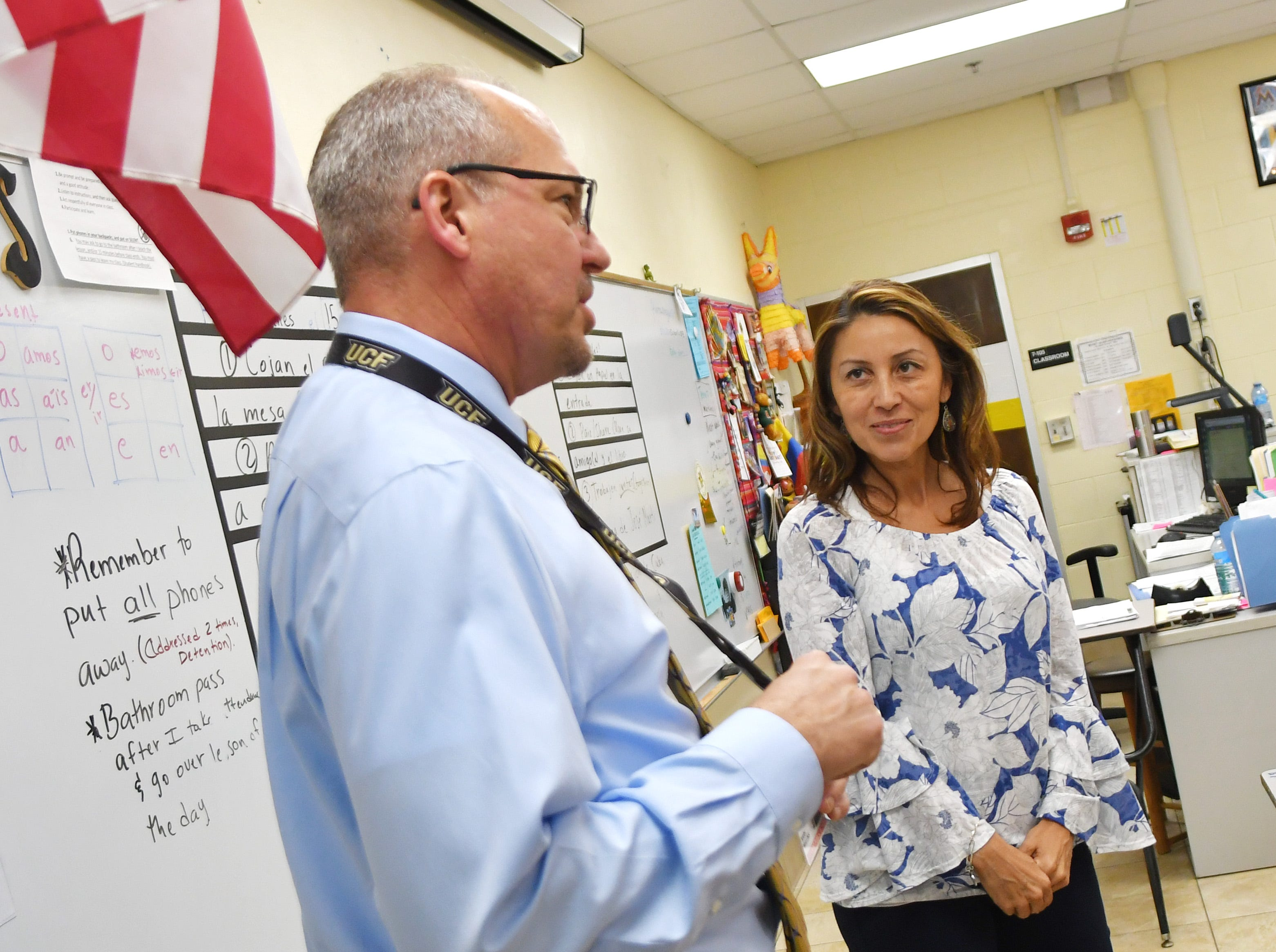 Brevard County Superintendent of Schools Mark Mullins, Ed.D, with Spanish teacher Angela Piloto at Merritt Island High School. MIHS was chosen as Mullins' host school after helping him raise the most money for his breast cancer awareness campaign.