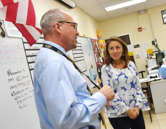 Brevard County Superintendent of Schools Mark Mullins is pictured with Spanish teacher Angela Piloto at Merritt Island High School.