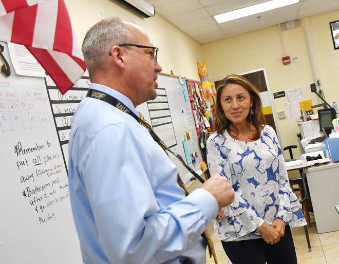 Brevard County Superintendent of Schools Mark Mullins is pictured with Spanish teacher Angela Piloto at Merritt Island High School.