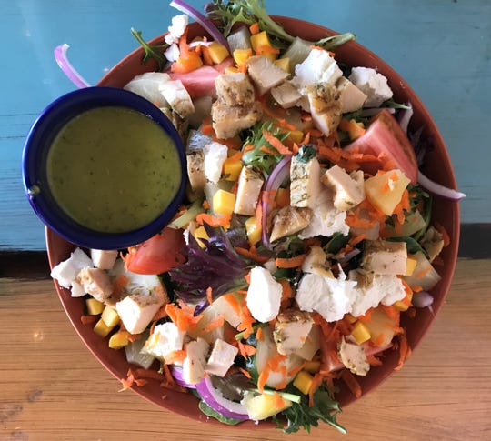 The Beach Salad at Beachfly Brewing Company in Indian Harbour Beach includes fresh tropical fruit, cucumbers, onions, tomatoes and goat cheese ($11). Add chicken for $3.