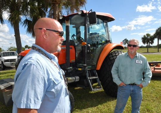 At Heritage High in Palm Bay, Matthew Nolle, ground services supervisor, and Paul Martin, equipment operator II. With so few employees and a tight budget to mow the grass and athletic fields, the Brevard school district's facilities team has been struggling to keep up, which sometimes results in tall, unruly grass.