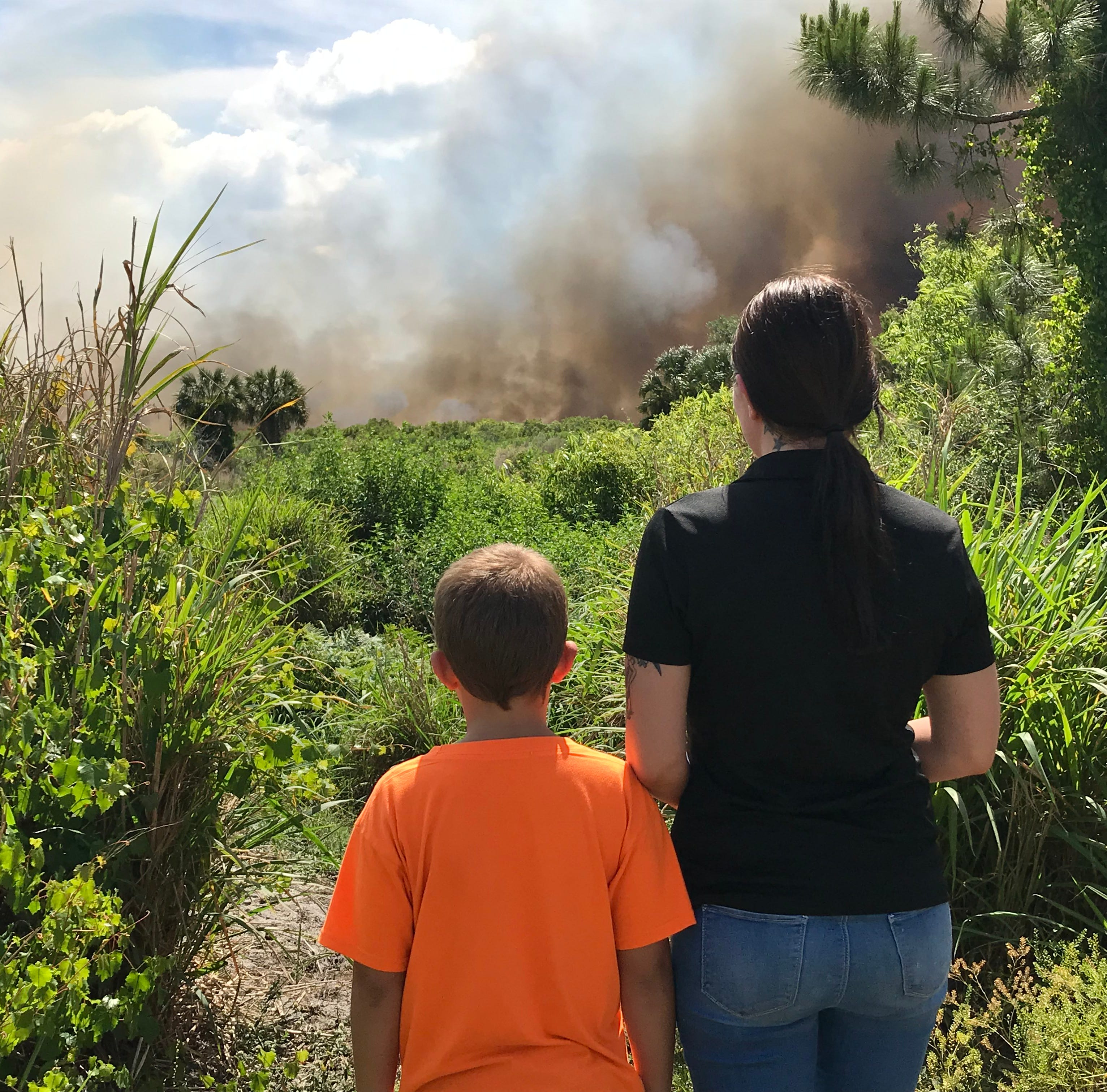 Smoke, flames, roadway shutdowns as Brevard firefighters tackle 300-acre Port St. John brush fire