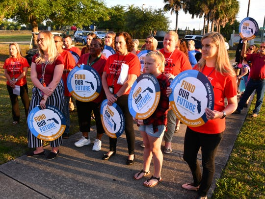 """A couple of dozen teachers, most wearing red T-shirts and chanting """"red for ed"""" did a walk in to school at Fairglen Elementary School in Sharpes to bring awareness to the need for for funding for schools. Teachers and some students held signs """"Fund our future""""."""