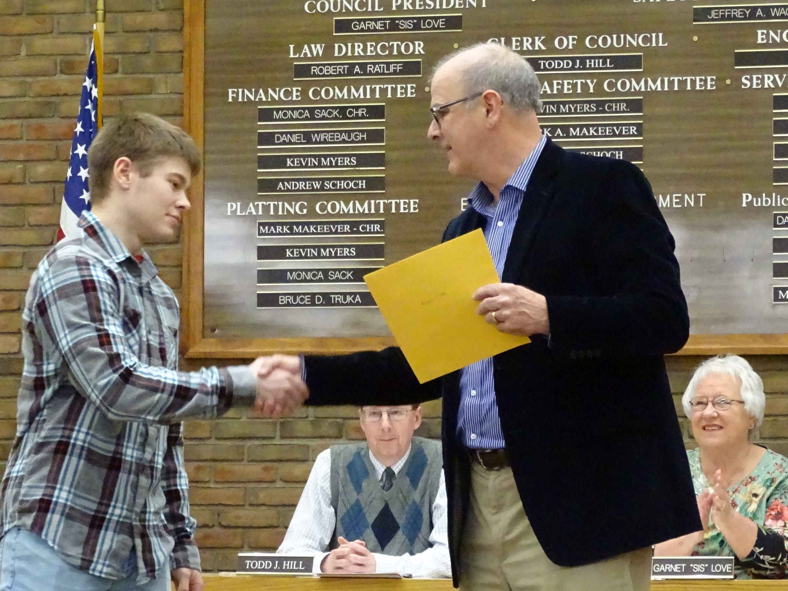 Andrew Pifer is honored by Mayor Jeff Reser during Tuesday night's Bucyrus City Council meeting.