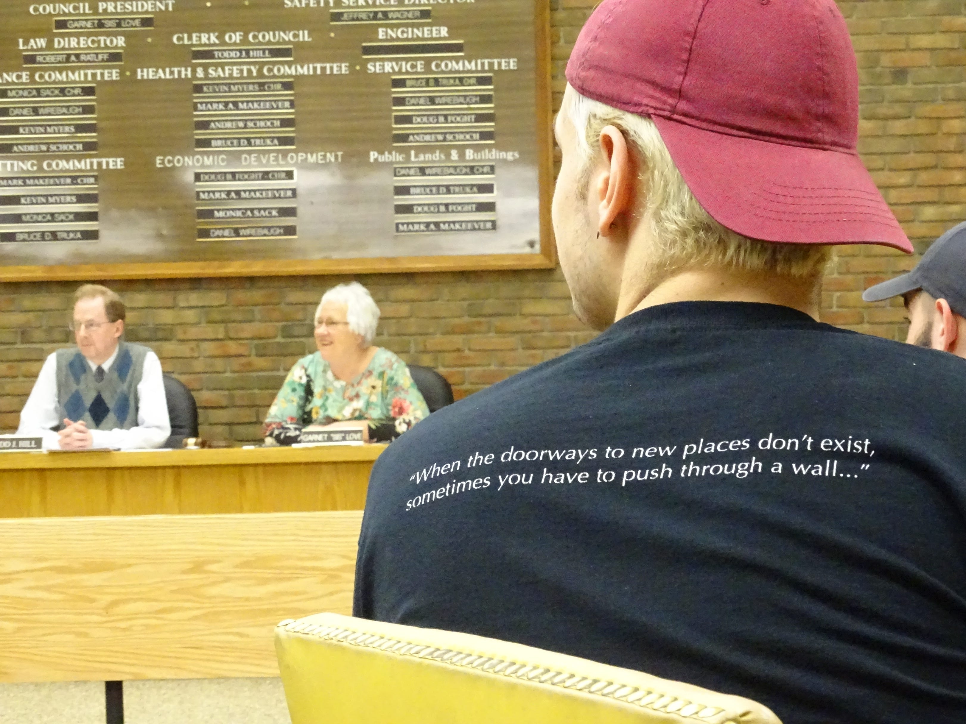 A member of the Bucyrus High School Xband watches Tuesday night's Bucyrus City Council meeting.